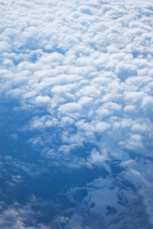 View from above of earth through clouds photo