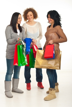 Full length of happy shoppers women friends having conversation  photo