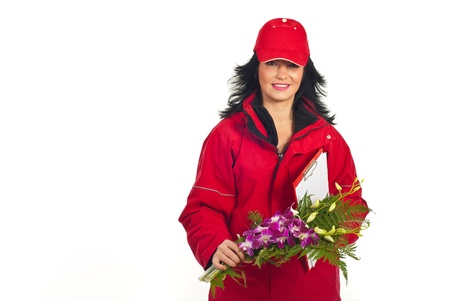 unifrom: Smiling woman in red unifrom delivering flowers bouquet isolated on white background Stock Photo