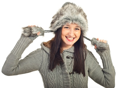 Laughing woman wearing fur grey hat isolated on white background photo