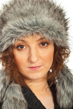 Close up of redhead woman in grey fur hat against white background photo