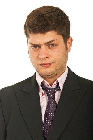 Portrait of  confused business man with grimace on his face isolated on white background Stock Photo - 12595186
