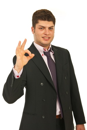 Successful young business man showing okay sign hand gesture isolated on white background Stock Photo - 12595170