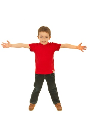 Happy boy wearing red blank t-shirt and standing with arms open isolated on white background