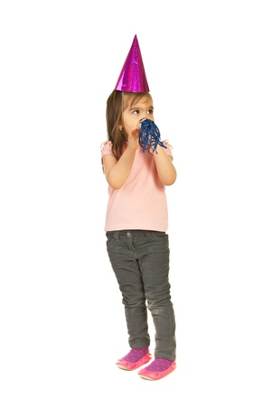 noise maker:  Full length of toddler girl wearing party hat and making noise with noise maker while looking away to copy space,isolated on white background