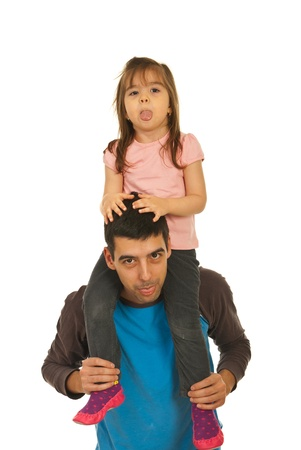 Funny father giving piggyback to his daughter and together posing with tongue out isolated on white background photo