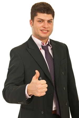 Smiling young business man giving thumb up isolated on white background photo
