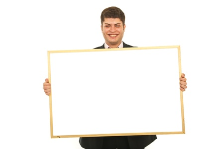 Laughing young business man holding blank banner isolated on white background Stock Photo - 12595282