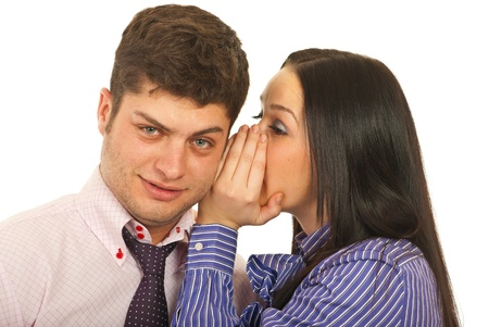 tells: Business woman telling a secret to his colleague  man isolated on white background