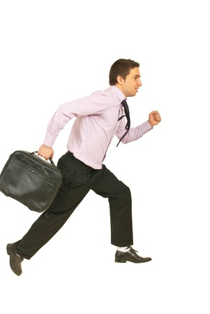 Running away business man to work holding suitcase isolated on white background photo
