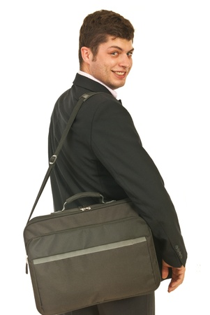 is over: Happy business man going to job and looking back over shoulder isolated on white background Stock Photo