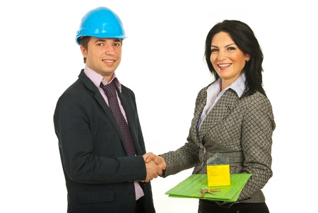 constructors: Handshake architect with buyer woman holding folder and miniature house with keys isolated on white background