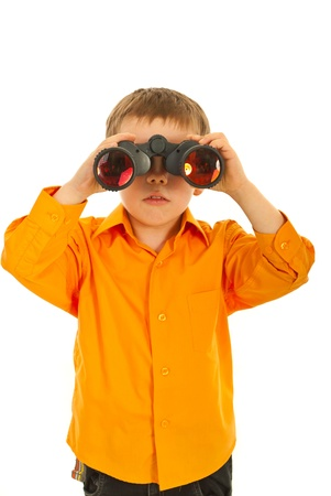 Boy looking through binocular straight ahead isolated on white background photo