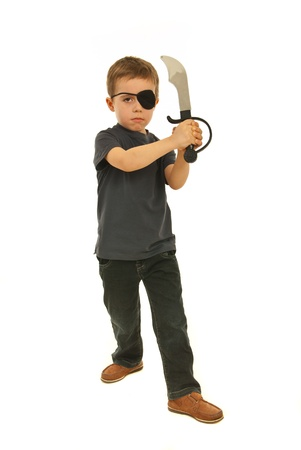 Boy with bandage eye holding sword and playing pirate isolated on white background photo