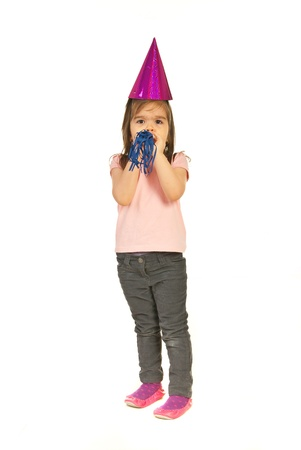 noise maker: Party girl  having powerful blow to the noise maker isolated on white background