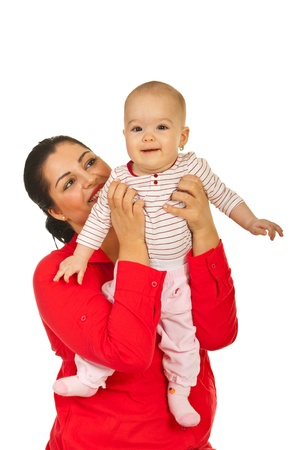 Happy mother holding her smiling daughter baby isolated on white background photo