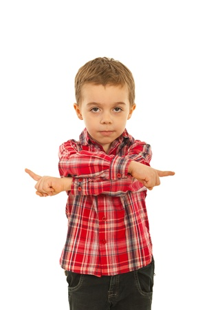 Confused boy pointing in both ways and asking for which direction isolated on white background