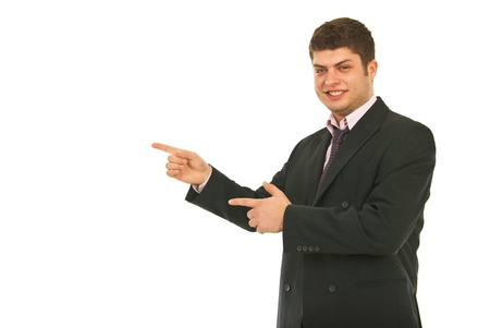 Young smiling business man indicate with both hands to copy space isolated on white background Stock Photo - 12595828