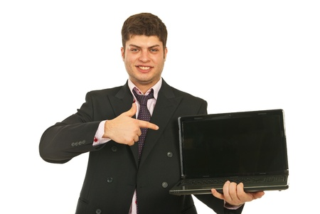 Business man pointing to empty laptop screen isolated on white background photo