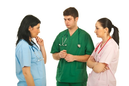 Sad team of three doctors having conversation and thinking at sollutions isolated on white background photo