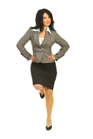 Proud business woman standing in on leg with hands on waist and having a good equilibrium isolated on white background Stock Photo - 12595837