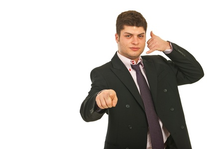 Young business man gesturing call me and pointing to you isolated on white background Stock Photo - 12595891