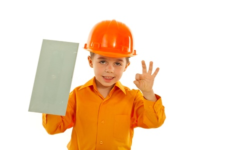 notched: Successful worker child showing okay sign hand gesture and notched isolated on white background Stock Photo