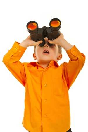 Surprised boy looking up through binocular siolated on white background photo