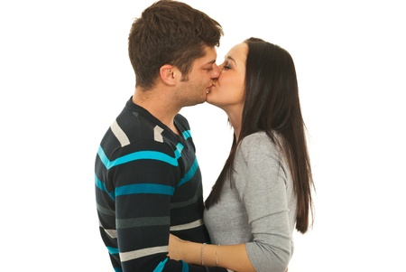 young couple hugging kissing: Loving couple kissing isolated on white background