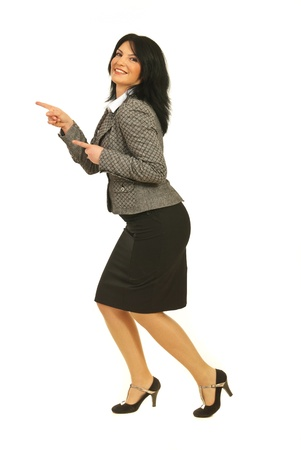both: Full length of joyful business woman  pointing with both hands to copy space in left part of image isolated on white background