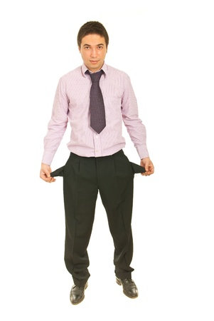 empty pockets: Full length of business man showing his empty pockets isolated on white background Stock Photo