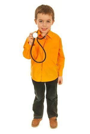 Little boy holding stethoscope isolated on white background photo
