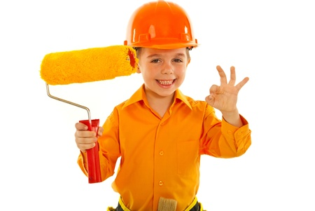 Successful painter worker boy showing okay sign hand gesture isolated on white background Stock Photo - 12596336