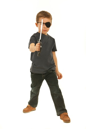 Pirate little boy holding sword toy isolated on white background photo