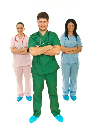 Full length of team of healthcare workers standing with arms folded isolated on white background photo