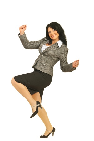 Successful business woman raising fists and being happy isolated on white background photo