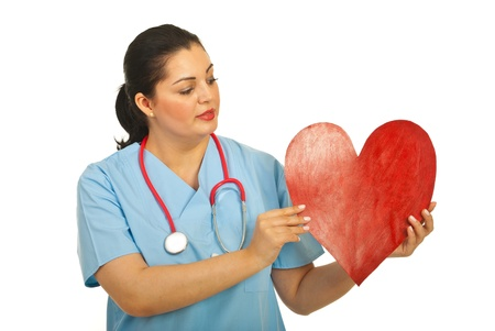 Doctor woman holding heart shape and looking to copy space of heart isolate don white background Stock Photo - 12596395