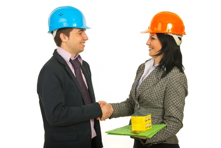 Two architects making a deal and shaking their hands isolated on white background photo