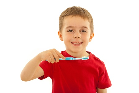 toothcare: Happy kid with toothy smile holding toothbrush isolate don white background