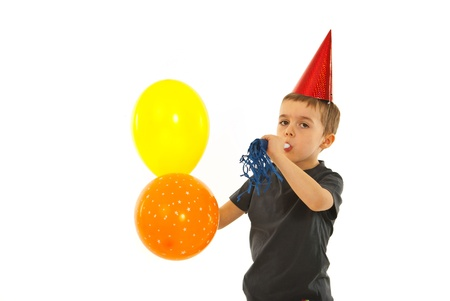 noise maker: Party child boy with noise maker and balloons isolated on white background Stock Photo