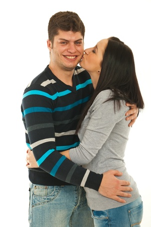 Woman kissing her boyfriend cheek isolate don white background photo