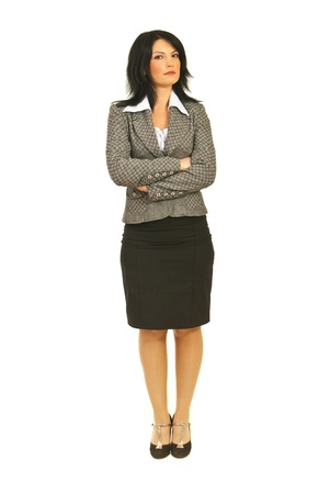 Full body of serious attractive business woman with attitude standing straight with arms folded isolated on white background photo