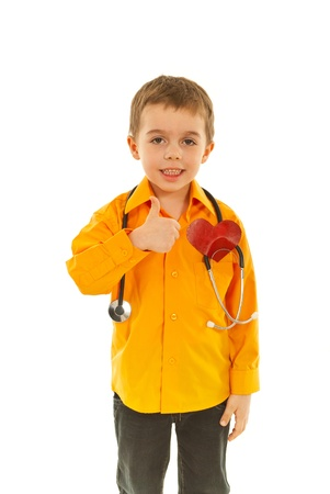 Successful future doctor boy giving thumb up isolated on white background photo