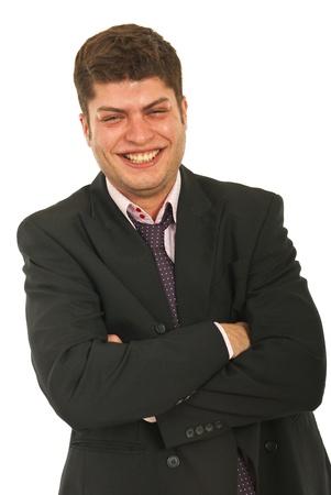laughing out loud: Hombre de negocios riendo en voz alta y de pie con los brazos cruzados sobre fondo blanco Foto de archivo