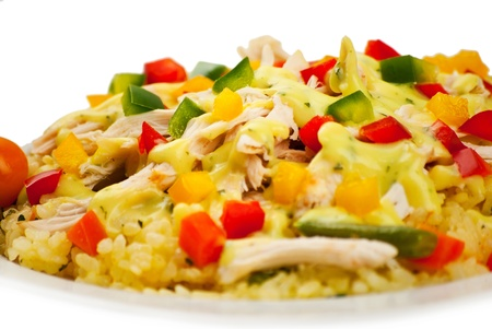 sause: Close up of chicken with rice , cut peppers and sause