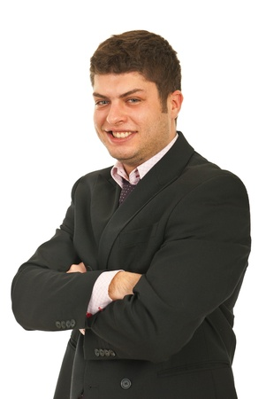 folded hands: Cheerful young business man standing with arms folded isolated on white background