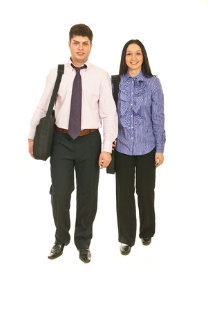Front view of two business people walking isolated on white background