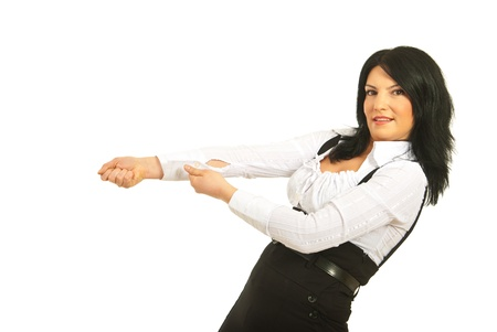 Business woman pulling something imaginary isolated on white background photo