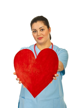 Doctor woman offering heart shape isolated on white background Stock Photo - 12596715
