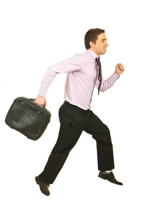 Happy business man running to work isolated on white background photo
